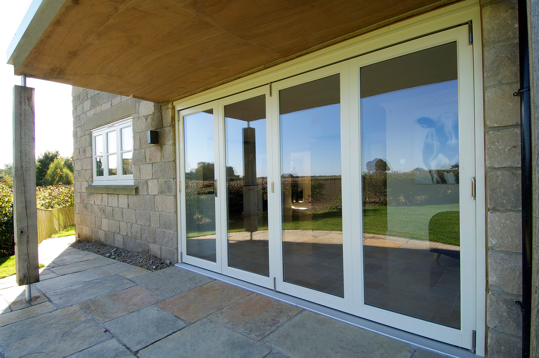 white wooden bifold patio doors