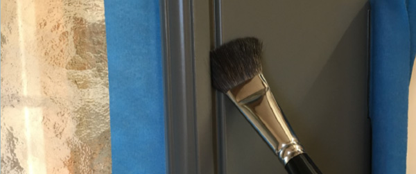 paint brush on wooden door