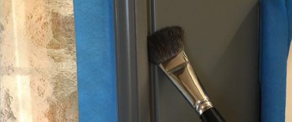paint brush on wooden door